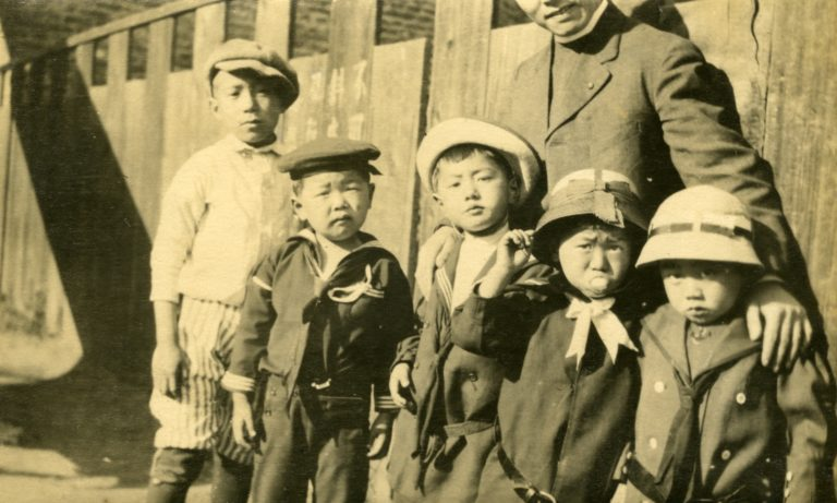 Fr. Wu and church children in front of Clay Street church c1920s